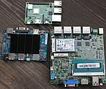 Some small x86 boards next to Raspberry Pi